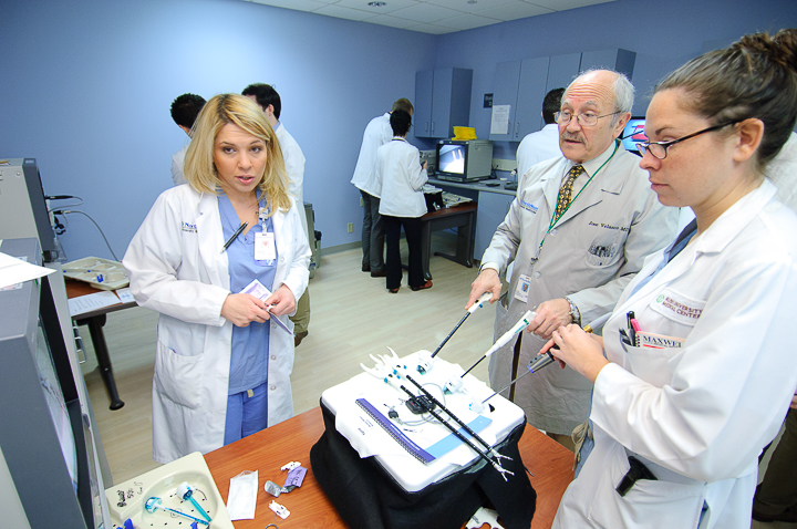 Jose Velasco, MD demonstrates laparoscopic practice techniques to NorthShore residents at the Skokie Hospital Simulation Center.