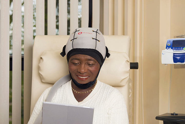 Patient using the PPaxman Scalp Cooling System®