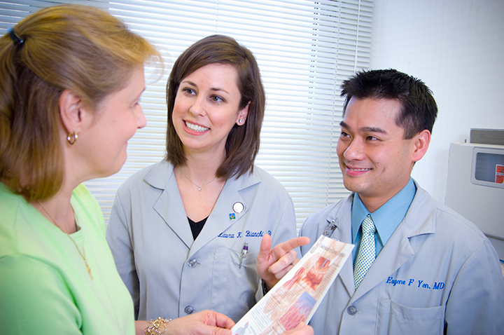 Dr. Laura Bianchi and Dr. Eugene Yen with patient