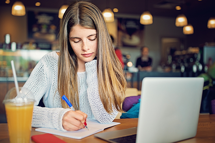 Female College Student Studying in a Cafe