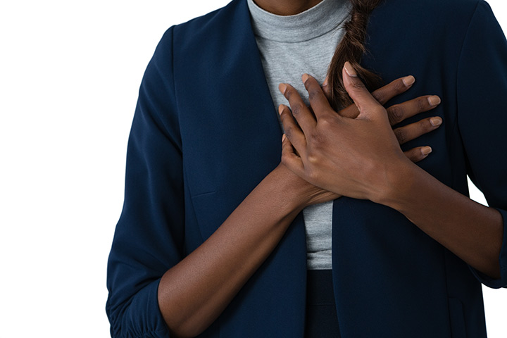 woman clutching her chest