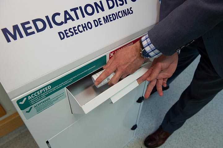 an individual disposing of their expired medication