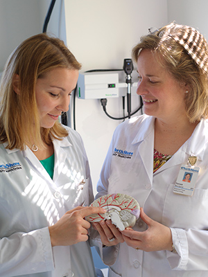 Nurses with model brain